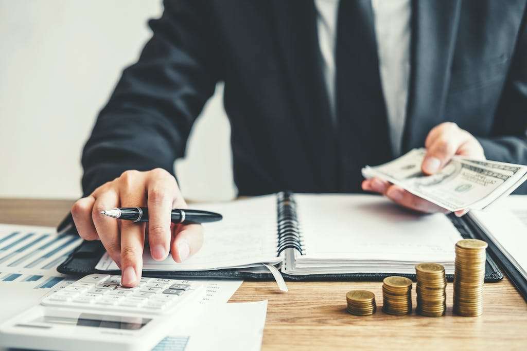 Business man calculating the cost of an LLC