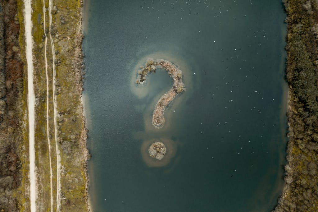 A lake with an island shaped as a question mark in the middle.