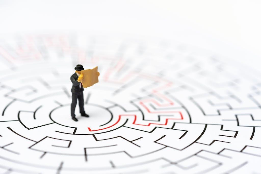 Toy businessman in maze