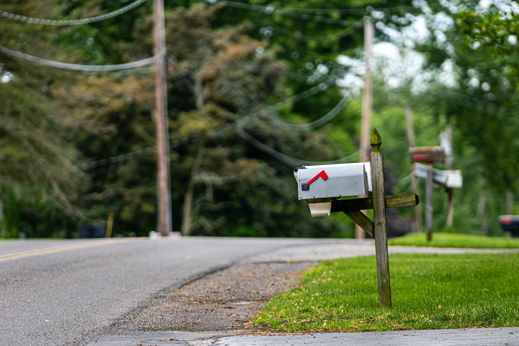 Traditional american mailbox on side of road